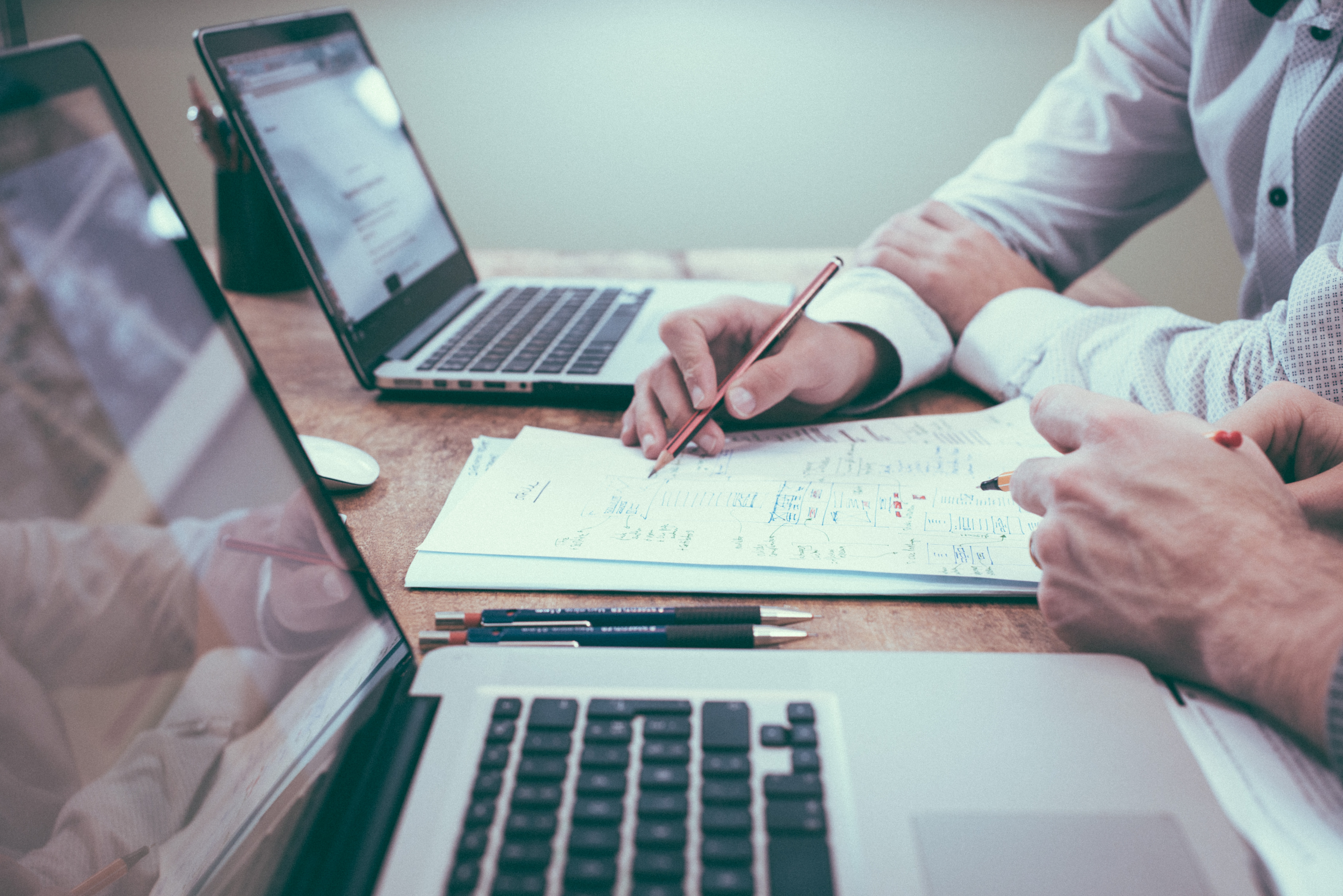 Laptops and list of considerations for appointing a new charity trustee. Photo by Scott Graham on Unsplash